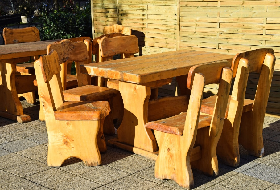 Wooden dining tables and chairs outdoors